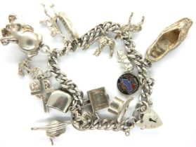 925 silver charm bracelet with fourteen charms, 49g. P&P Group 1 (£14+VAT for the first lot and £1+