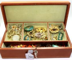 Leather jewellery box containing a large quantity of costume jewellery to include jade and silver