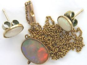 Presumed 9ct opal set pendant necklace (chain broken) with a pair of opal set earrings, hallmarks