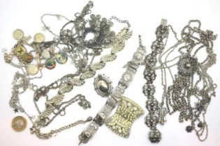 Tray of silver and white metal jewellery including a charm bracelet. P&P Group 1 (£14+VAT for the