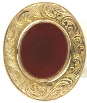 19th century 9ct gold swivel brooch mounted with bloodstone and carnelian, marks rubbed, L: 3 cm,