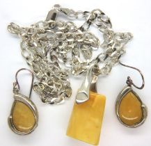 A silver butterscotch amber set pendant and necklace and earrings. Chain L: 60 cm, earring L: 30 mm.
