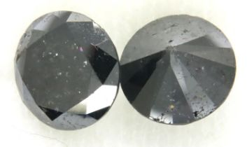 Two loose AIG certified black diamonds, each over 4cts. P&P Group 1 (£14+VAT for the first lot