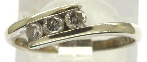 9ct white gold three stone (totalling 0.25cts) diamond crossover ring, size K, 1.8g. P&P Group 1 (£