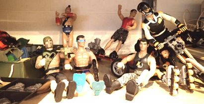Shelf of Action Men figurines and a selection of clothes and accessories. P&P Group 3 (£25+VAT for