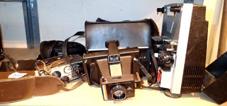 Vintage Sportstar Bell and Howell video camera, a Hanimex loadmatic 720 projector and further