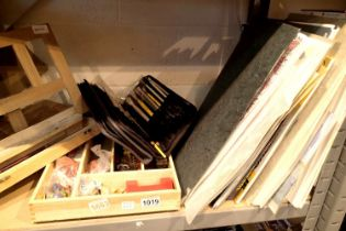 Shelf of mixed drawing and painting items to include a pop-up easel and used paint brushes etc.