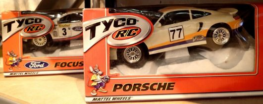 Boxed Tyco RC Mattel wheels remote controlled Ford Focus and a Tyco RC Mattel wheels racing remote