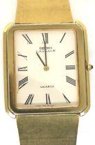 Seiko Lassale; gents slim profile quartz wristwatch on a gold plated bracelet, working at lotting