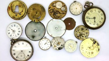 Two pocket watches, a hallmarked silver pocket watch case and a quantity of dials, movements etc.