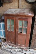 *WOODEN CABINET WITH ANGLED TOP AND GLAZED/PANELLED DOORS, 115CM X 49CM X 162CM
