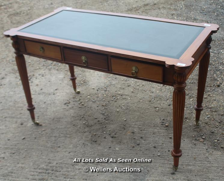 ANTIQUE THREE DRAWER LEATHER TOP WRITING DESK ON TURNED LEGS AND CASTERS, 125CM WIDE, 65CM DEEP,