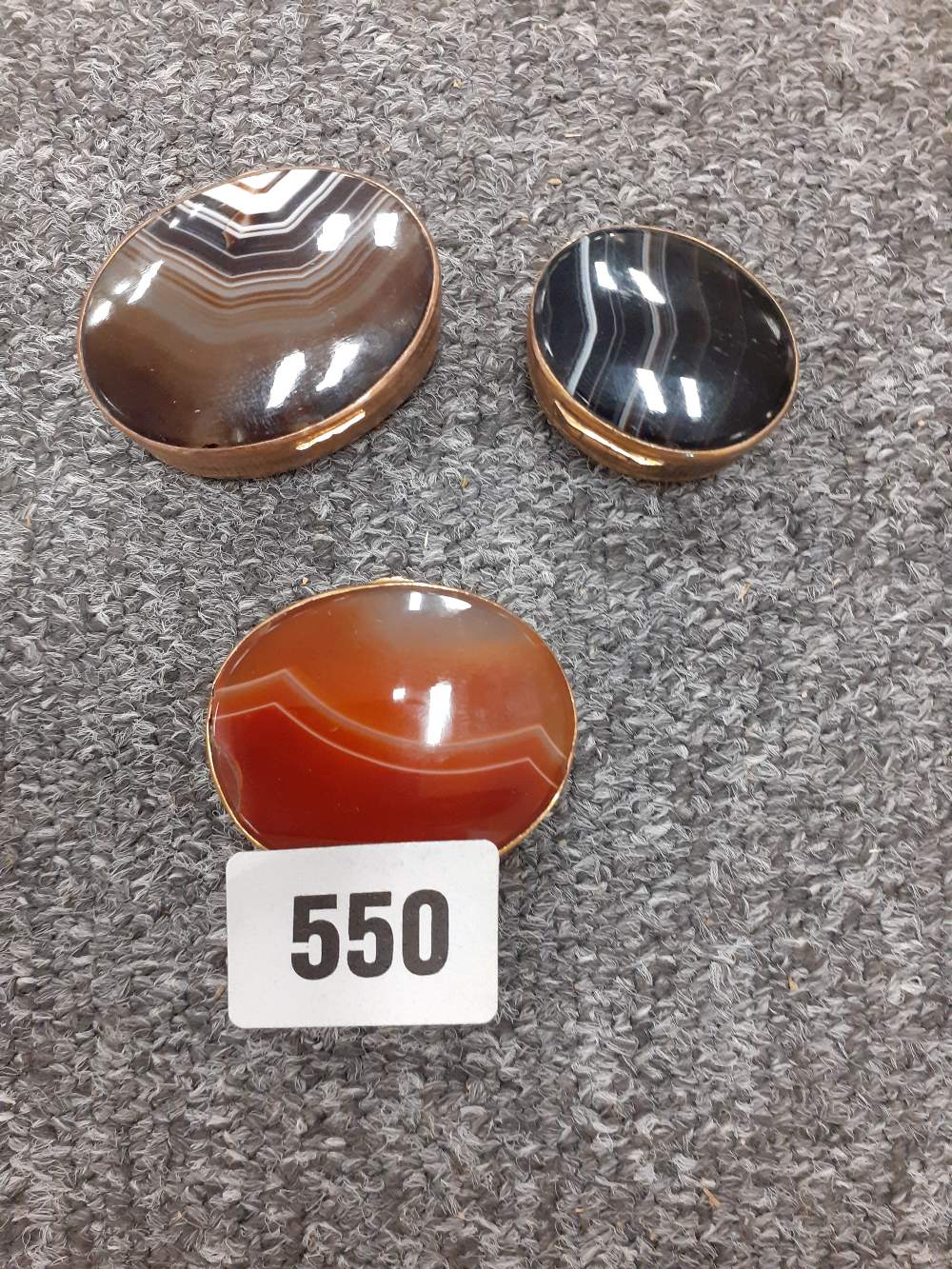 THREE 19C GILT AND AGATE PILL BOXES