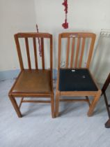 Two beech faux leather drop seated chairs