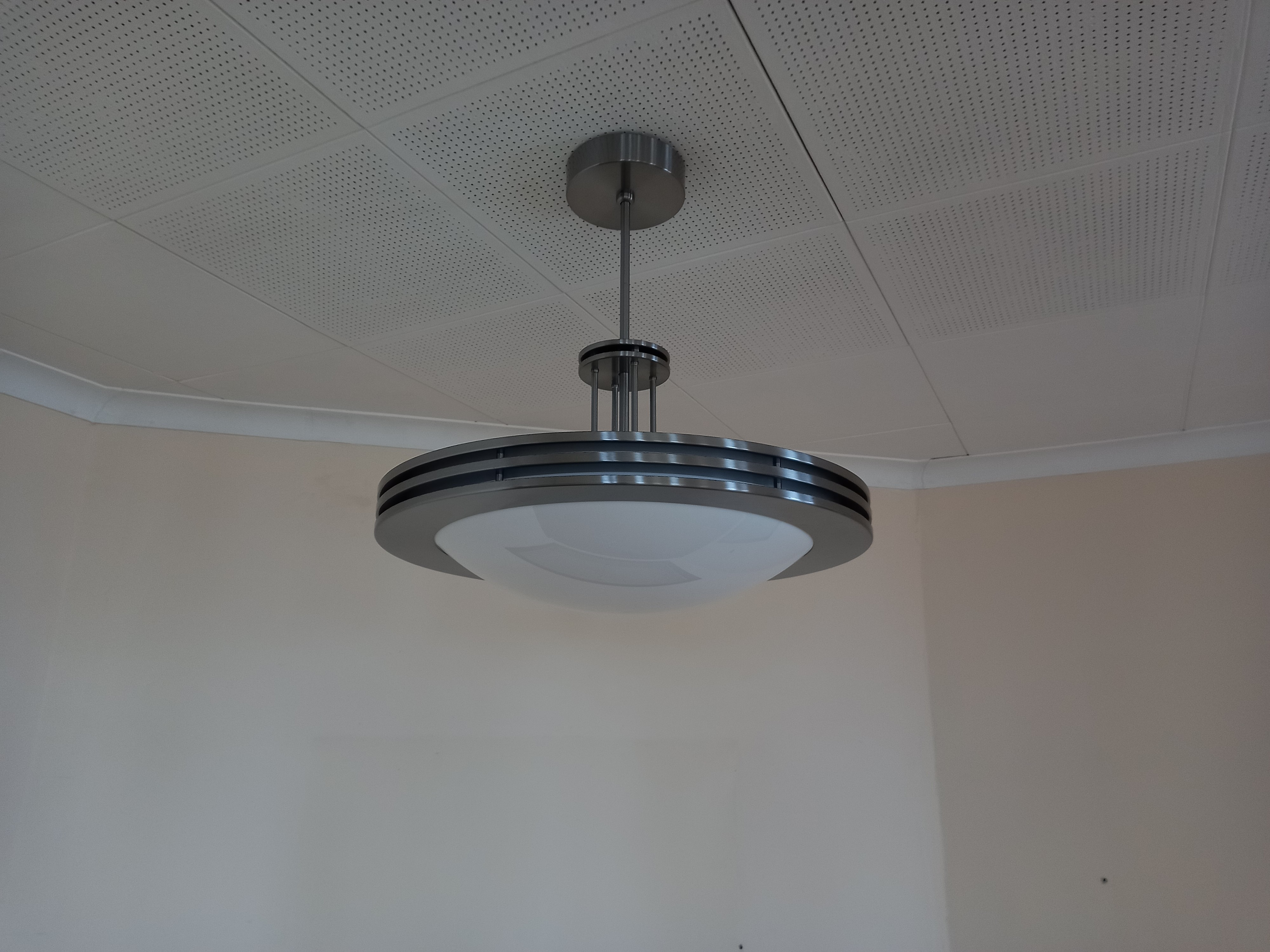 An Art deco style chrome hanging ceiling light fitting