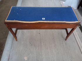 An Edwardian Mahogany duet stool.