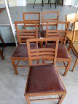 Six faux leather drop seated chairs
