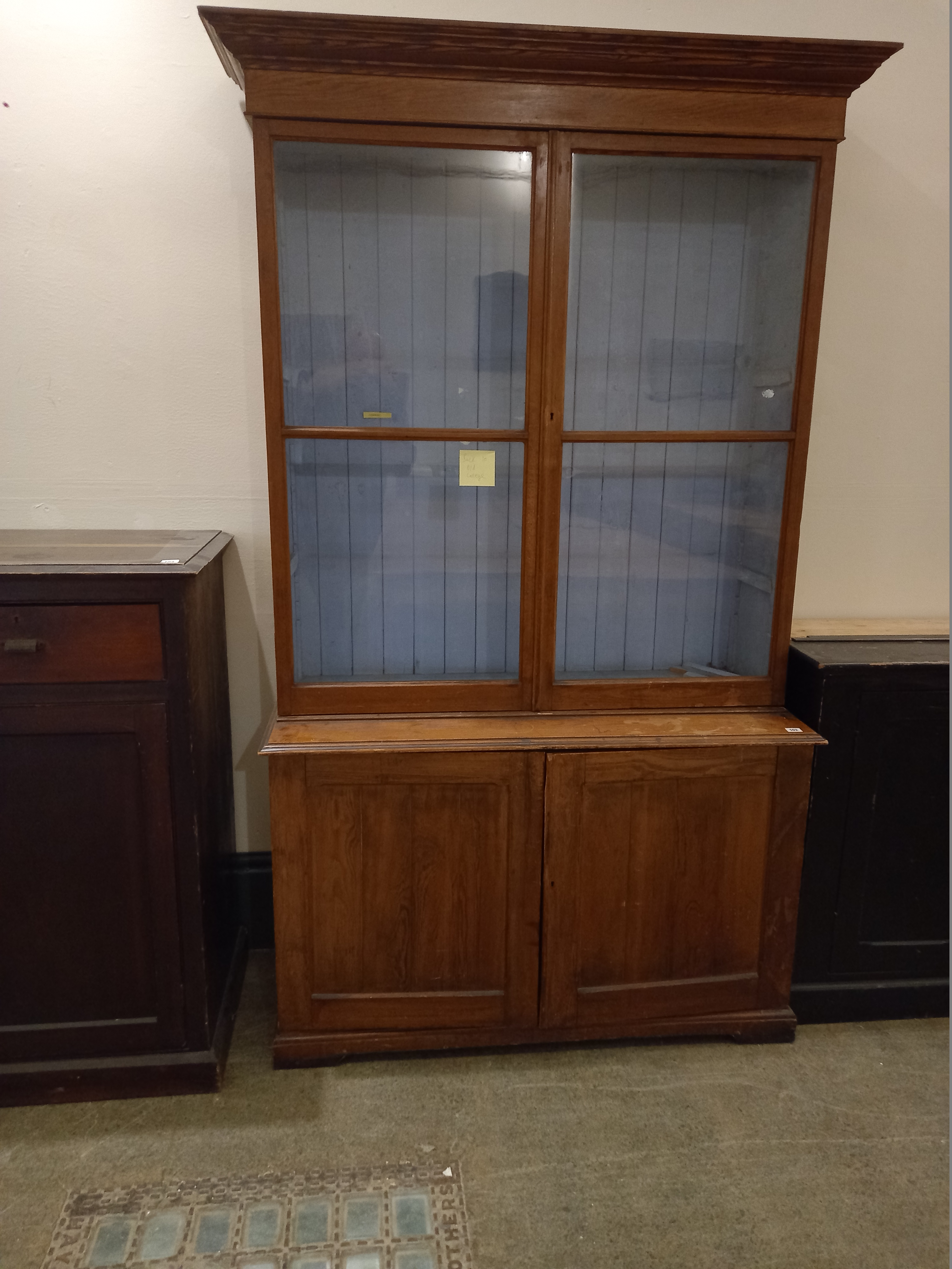 """A Victorian pine bookcase with glazed doors 18""""x49"""" x 85"""" high"""