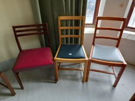 Three faux leather drop seated chairs