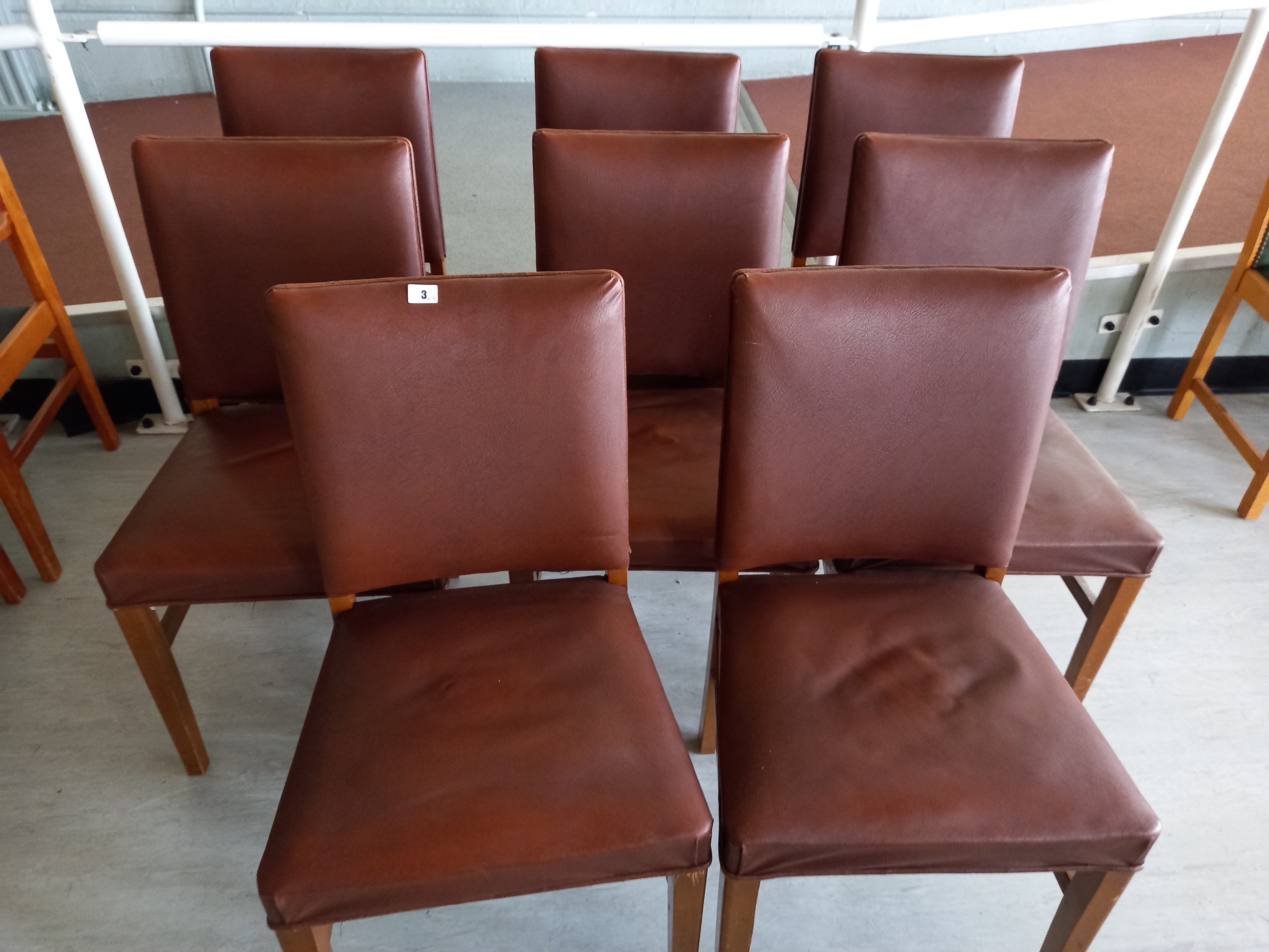 Eight Faux leather backed chairs