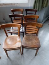 Six mixed light and dark stained beech chairs
