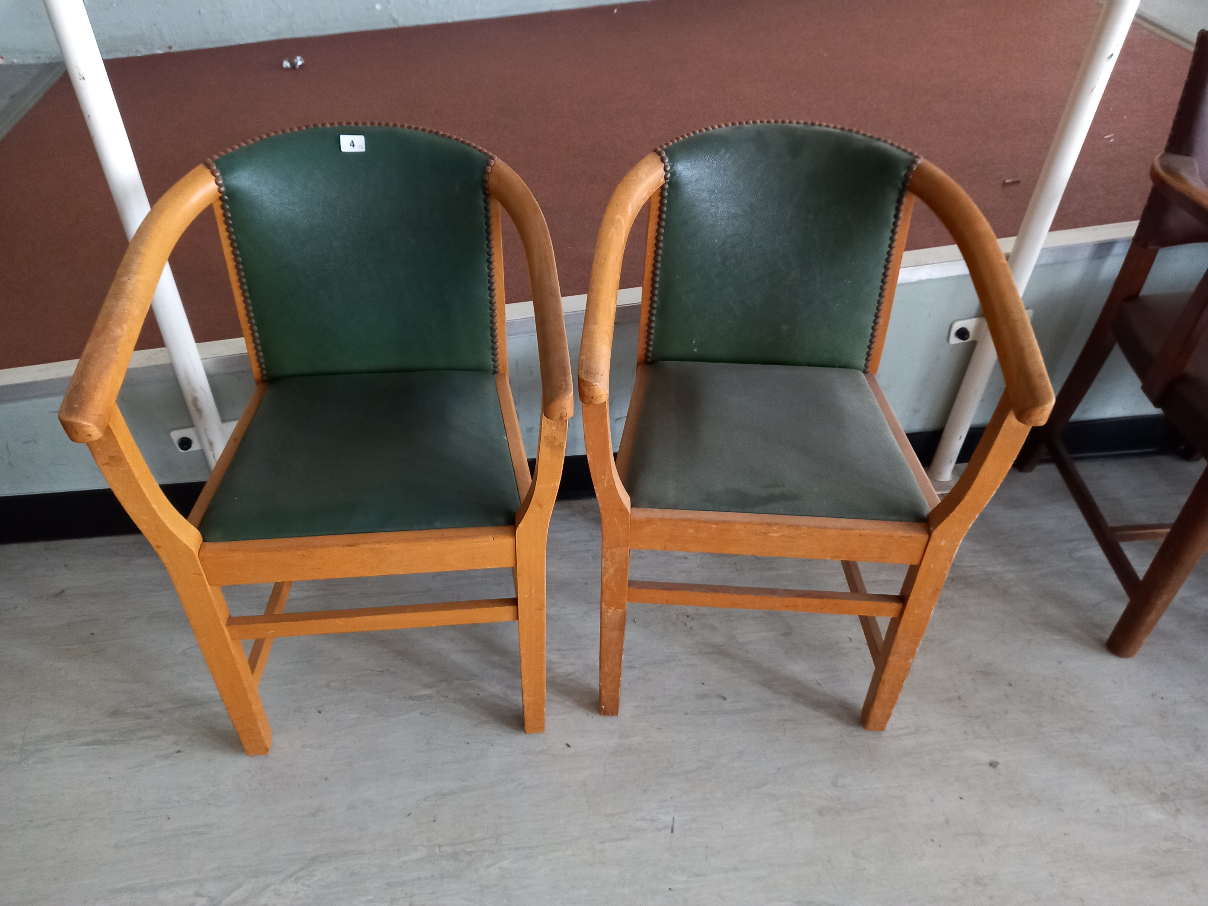 Two faux leather backed elbow chairs