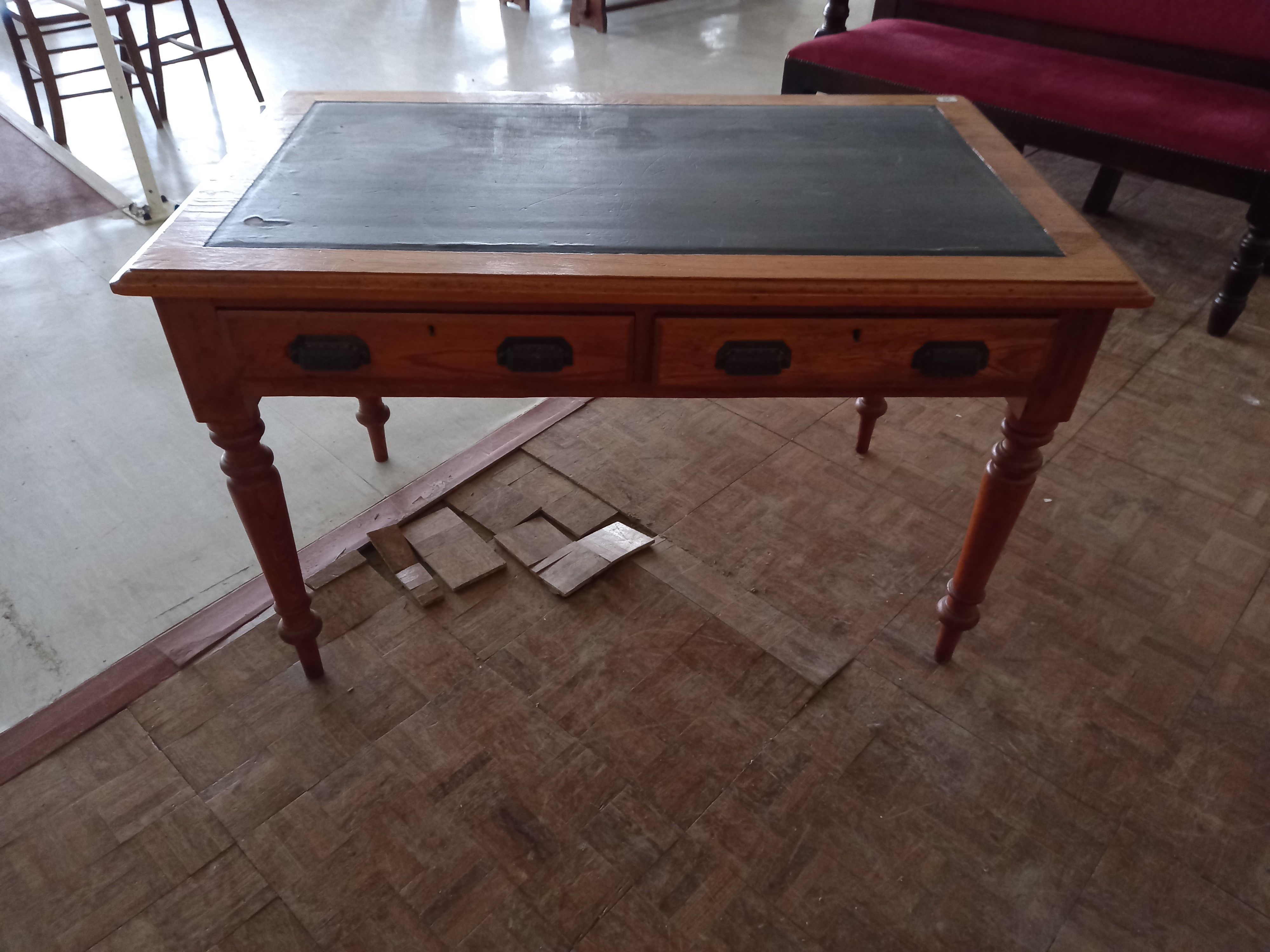 A Victorian Pine two drawer desk with faux leather top