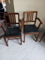 Two faux leather drop seat elbow chairs