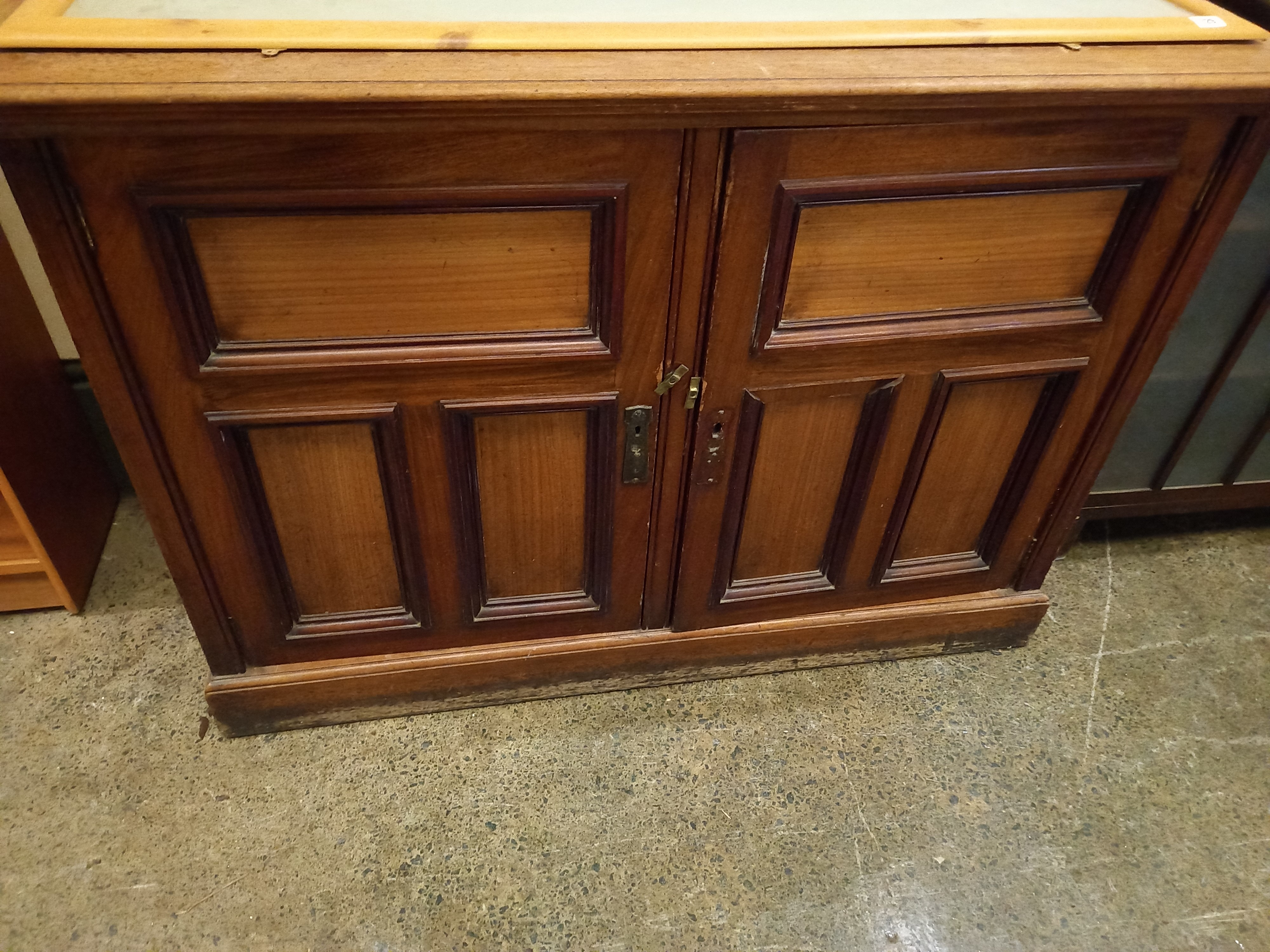 A Victorian mahogany panelled two door cupboard