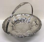 A heavy circular George IV silver swing handled ba