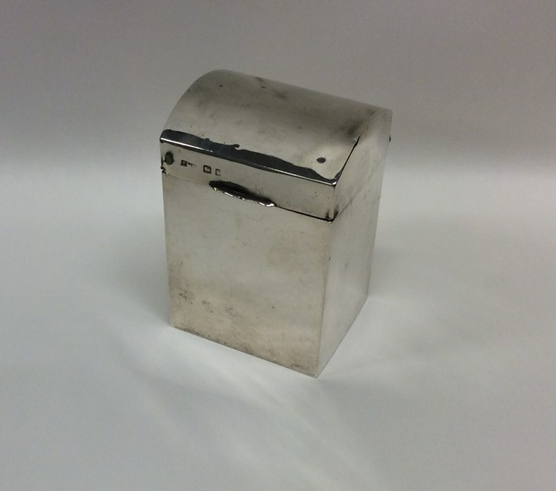 An unusual silver dome top double compartment box.