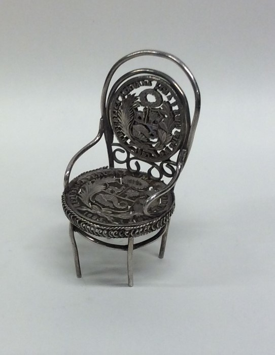 A Continental silver novelty model of a chair with