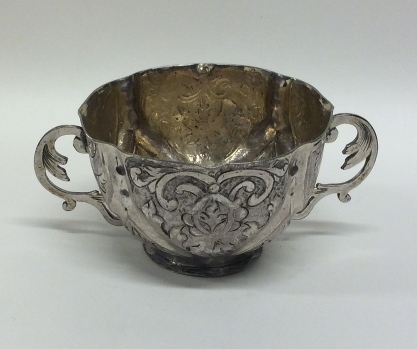 A Continental silver two handled cup with gilt int