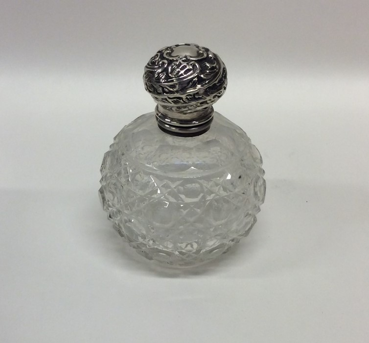 A silver mounted hobnail cut scent bottle with gil