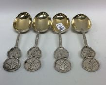 A heavy set of four Chinese silver teaspoons with