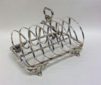 A good Georgian silver seven bar toast rack / smar