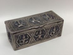 A rectangular Indian silver box with hinged lid. A