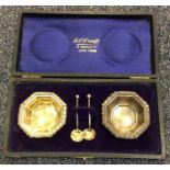 A cased pair of Edwardian silver salts together wi