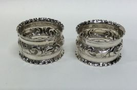 A pair of Edwardian silver embossed napkin rings.