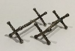 A good pair of heavy cast silver knife rests. Birm
