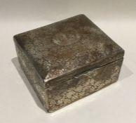 An attractive engraved silver cigarette box decora