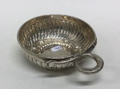 A heavy Antique silver bleeding bowl of fluted des