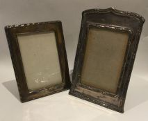 Two good silver picture frames with shaped edges.
