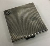 A heavy Art Deco silver cigarette case with reeded