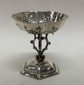 A Continental silver table toy decorated with scro