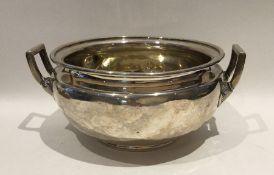 A good Georgian circular silver sugar bowl with lu