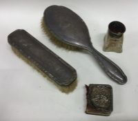 A bag containing silver mounted hairbrushes, dress