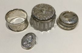 A silver engraved napkin ring together with an emb