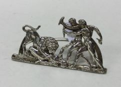 A rare silver menu holder in the form of two men k