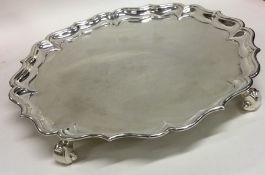 A heavy George II circular silver salver on three
